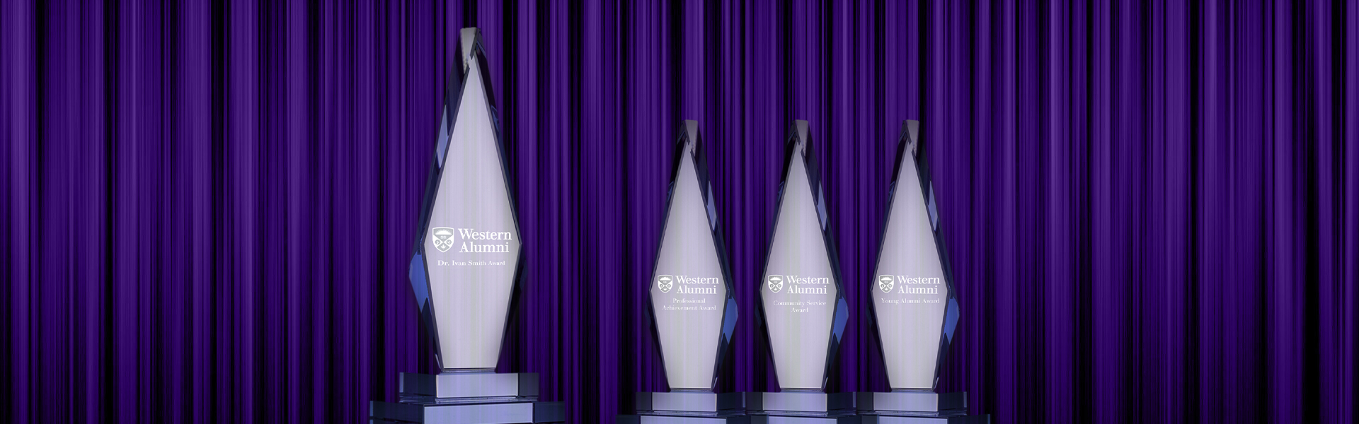Awards of Merit shown in front of a purple curtain
